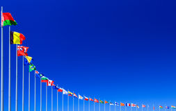 Flags against blue sky Royalty Free Stock Photos