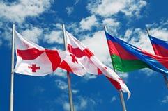 Flags against sky Stock Photos
