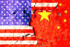America and China flags. Flags of america and China is painted on old wall royalty free stock images