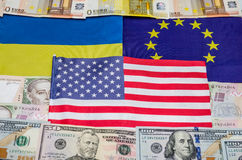 Flags of America of Europe and Ukraine with money Stock Photos