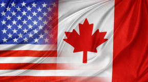 Flags. American and Canadian flags together royalty free stock photos