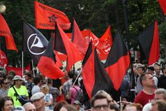 Flags of anarchists and left on oppositional meeting Royalty Free Stock Photography