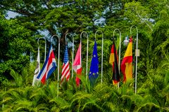 Flags from around the World. Multiple flags from around the world in a beautiful park in Costa Rica stock photos