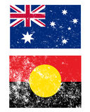 Flags of Australia. A pair of grunge style flags of Australia The aboriginal flag and the standard flag stock illustration