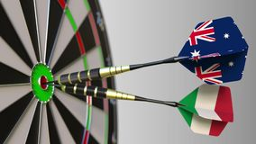 Flags of Australia and Italy on darts hitting bullseye of the target. International cooperation or competition. Animation stock video