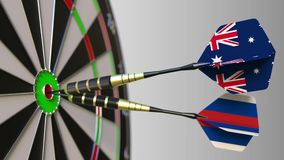 Flags of Australia and Russia on darts hitting bullseye of the target. International cooperation or competition. Animation stock footage