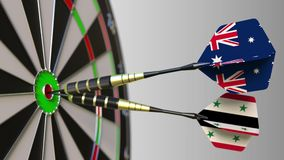 Flags of Australia and Syria on darts hitting bullseye of the target. International cooperation or competition. Animation stock video