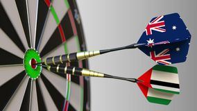 Flags of Australia and the UAE on darts hitting bullseye of the target. International cooperation or competition. Animation stock video