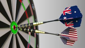 Flags of Australia and the USA on darts hitting bullseye of the target. International cooperation or competition. Animation stock footage