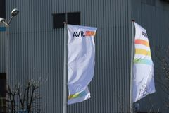 Flags of the AVR at their waste incineration at the Botlek harbor in the port of Rotterdam in the Netherlands. Flags of the AVR at their waste incineration at stock photo