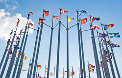 Flags on background of the blue sky with clouds Stock Image