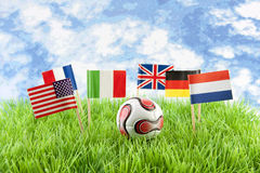 Flags and ball on soccer field Stock Photography