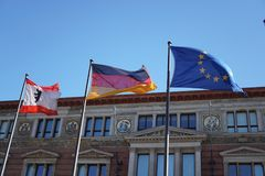Flags of Berlin, of Germany and of the European Union. Berlin, Germany - May 5, 2018: Flags of Berlin, of Germany, of European Union waving outside the Royalty Free Stock Photos