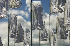 Flags blowing in wind. Multiple gray flags blowing in wind Royalty Free Stock Photos