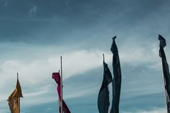 Flags blowing in the wind stock image