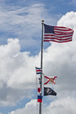 Flags and Blue Cloudy Sky Royalty Free Stock Photo