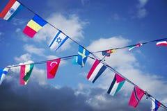 Flags on blue sky Stock Photos