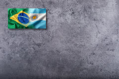 Flags of the Brazil and the Argentina on concrete background Royalty Free Stock Photo