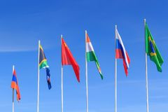 Flags of BRICS countries on a blue sky background stock photography
