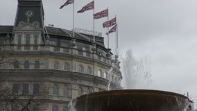 Flags of Britain on a background of a fountain. stock video footage