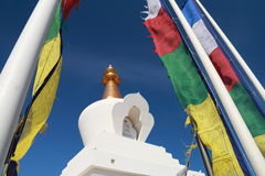 Flags and Buddhist temple Stock Images