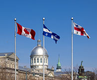 Flags of Canada, Quebec and Montreal in Old Port royalty free stock image
