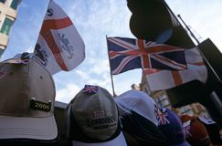 Flags and caps for sale, London Stock Photos