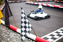 Flags and cars on carting track. Different flags and cars on carting track stock photos