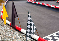 Flags on carting track. Different flags on carting track stock photo