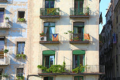 Flags of Catalan separatists on buildings in Barce Stock Image