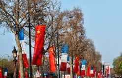 Flags on Champs-Elysees in Paris. With its cinemas, cafes, luxury specialty shops, the Champs-Elysees is one of the world's most famous streets royalty free stock images