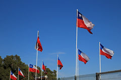 Flags of Chile on the sky Stock Image