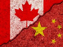 Flags of China and Canada painted on cracked grunge wall background/Canada and China relations and conflict concept.  royalty free stock photos