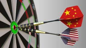 Flags of China and the USA on darts hitting bullseye of the target. International cooperation or competition conceptual. Flags of China and the USA on darts stock video