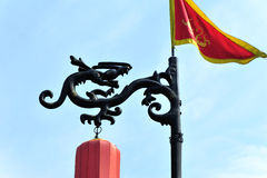Flags and chinese dragon Stock Photography