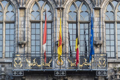Flags on City Hall facade in Mons, Belgium. Flags waving on City Hall building facade in Mons, capital of the Wallonian province of Hainaut in Belgium Royalty Free Stock Photo