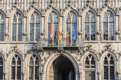 Flags on City Hall facade in Mons, Belgium. Flags waving on City Hall building facade in Mons, capital of the Wallonian province of Hainaut in Belgium Royalty Free Stock Image