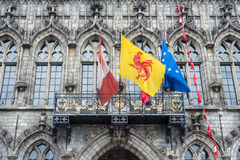 Flags on City Hall facade in Mons, Belgium. Flags waving on City Hall building facade in Mons, capital of the Wallonian province of Hainaut in Belgium Stock Photography