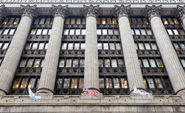 Flags and Columns on Massive Chicago Building Royalty Free Stock Image