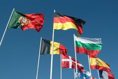 Flags of countries. Waving to the wind royalty free stock image