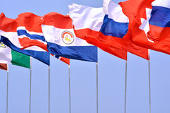 Flags of countries. Different countries national flags getting together under blue sky Royalty Free Stock Photography