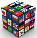 Flags of countries on the faces of the cube. Flags of various countries on the faces of the cube. The three-dimensional illustration.  on white surface Stock Photos