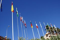 Flags of countries. Countries national flags on posts in Spain Stock Photo