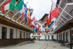 The flags of the countries participating in the Olympic games in. Flags of the countries participating in the Olympic games in Sochi in 2014, Rosa Khutor Royalty Free Stock Photos