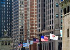 Flags of Country, State and City fly over bridge on Michigan Avenue, Chicago. Flags of Country USA, State Illinois and City Chicago fly over bridge on Michigan Royalty Free Stock Image