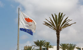 Flags of Cyprus and European Union on Paphos summer resort. With palms Royalty Free Stock Photos