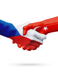 Flags Czech Republic, Turkey countries, partnership friendship handshake concept. Stock Images