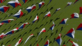 Flags of Czech Republic view from above in green field. Many flags of Czech Republic view from above in green field in sunny day. rendering 3D illustration Royalty Free Stock Images