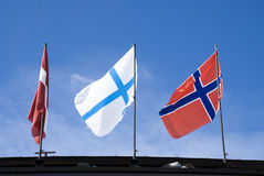 flags den lathuile skyen arkivbilder