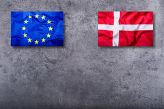 Flags of the Denmark and the European Union on concrete background Stock Photo